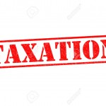 TAXATION red Rubber Stamp over a white background.